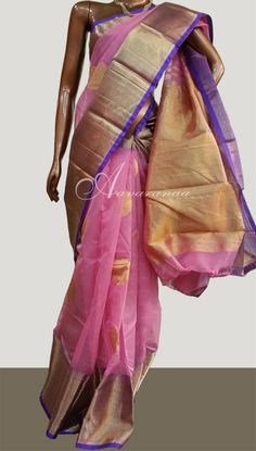 A beautiful pink organza silk saree featuring a rich kancheepuram silk border and pallu in a single weave. This saree uses multiple materials in a single wevae, making it ideal for weddings and parties. #organza #kancheepuram #gaurang #aavaranaa #partywear #indianbride #bridalattire #new #100sareepact