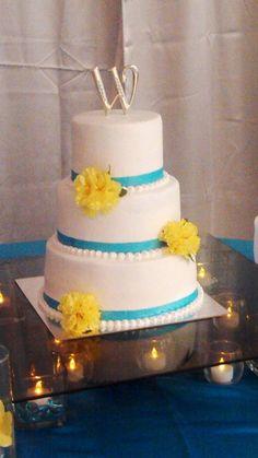 Blue and Yellow Wedding Cake Bake Your Day, LLC - Alexandria, LA www.facebook.com/bakeyourdayllc (318) 229-0299 bakeyourdayllc@hotmail.com
