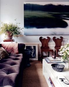 the pastoral photography gives the room an airy, spacious feel.    #art #livingroom #undecorate