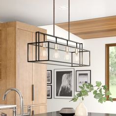 null Farmhouse style gets a modern lift with this pendant light. The open rectangular metal frame is suspended by two adjustable downrods and is available in different solid finishes so you can find the one that best suits your space. Four Edison bulbs are included (#score), and give this pendent some serious retro vibes. This pendant light is compatible with sloped ceilings and is dimmable, so you can set it for any mood. This light is dry-listed only, so it's best in kitchens or dining…