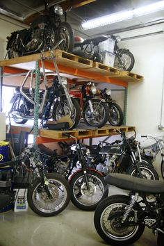 These vintage motorcycles in the Champions Moto shop are waiting to be restored.
