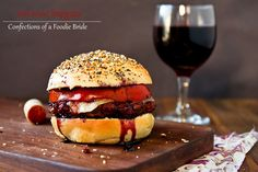"""Cabernet Burgers on """"Everything"""" Buns    Juicy burgers spiked with a reduction of your favorite red wine, paired with an """"everything"""" burger bun.  Ingredients        2 cups of your favorite red wine      2 Tbsp brown sugar      1 lb lean ground beef      Salt      Pepper      Worcestershire sauce      1 medium slicing tomato, cut into 1/2 inch slices      Olive oil      3 Burger buns (""""everything"""" buns pictured)      3 slices of your favorite cheese"""