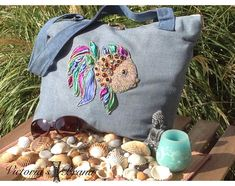 Denim, seed beads, Swarovski stones, shibori silk bag. For example only to order. I suggest you create and make a custom bag. Or depending on your model.