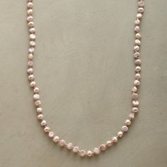 """HINT OF PINK NECKLACE--Freshwater pearls in blush pink and faceted nuggets of sparkling zircon come together in a subtly stunning necklace to wear long or wrapped. By Lena Skadegard. 18kt gold vermeil S-hook. Exclusive. 58""""L."""