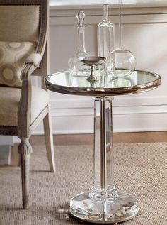 An occasional table is a handy piece of furniture can be placed just about anywhere and has a multitude of different functions.  http://www.invitinghome.com/tables-glass-marble-top/silver-crystal-table.htm  #Mirror #Table