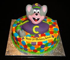 chuck e cheese cake Chuck E Cheese themed cake Cake iced with