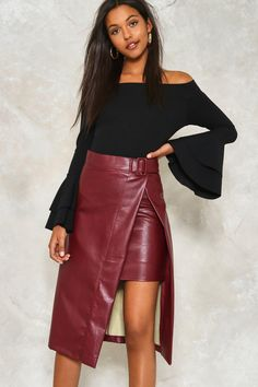 Or slit this one out. The Take It Up With Me Skirt comes in vegan leather and features a high-waisted, midi silhouette, wrap design, slit at side, and buckle closure at waist.