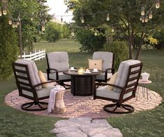"""5 pc Castle island collection 48"""" Round dark brown metal patio fire pit coffee table and swivel chairs. Swivel chairs measure 30.5"""" x 35"""" x 40"""" H. Table measures 48"""" x 48"""" x 25"""" H. Some assembly required."""