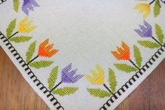 Very well done vintage 1960s handmade cross-stitch embroidery yellow/purple/orange tulip flower motive on beige linen tablet/ table-cloth
