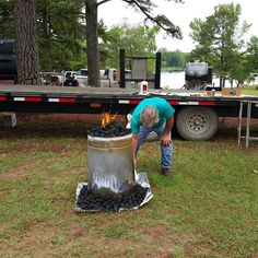 Preparing to cook a turkey in a trash can with charcoal briquettes at the Cookin' for the Kids Dutch Oven Cook Off on Petit Jean Mountain, AR.