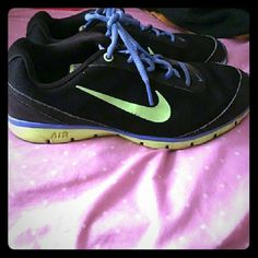 Nike Air Training Total Core athletic shoe black 7 Nike Air Training Total Core athletic shoe black blue and neon yellow/green. Sz 7. Nike Shoes Athletic Shoes