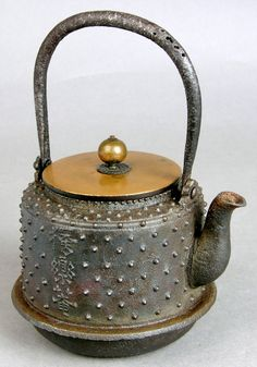 Object of the Day - Tetsubin (Cast Iron Kettle):Tetsubin are a product of the Nambu region of northern Japan, where ironwork forges have been in operation since the Heian Period (794-1185). The area began producing kettles in the Edo Period (1615-1868), however. Such kettles usually heated water over coals in the portable braziers called hibachi, the principal heating device in a Japanese home until well into the 20th century. #tea #iron #tetsubin #japan #morikami