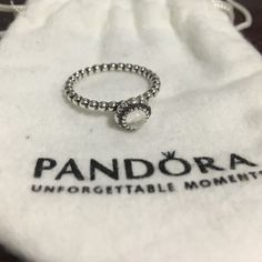 Authentic Pandora April Birthstone Ring Birthday Bloom collection. April. Clear stone to represent the Diamond birthstone. Size 60 (9). Never worn, stamped (pictured, just hard to tell my apologies). Pandora Jewelry Rings