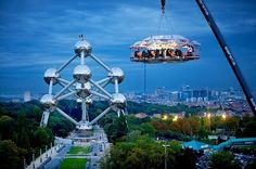A company called Dinner in the Sky uses a crane to lift up this big table into the sky, and then three professional chefs whip up something delicious.   They do weddings, film screenings, meetings, and just about anything you can think of too!