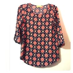 Vibrant Top Great condition; fold/button detail on the 3/4 sleeves. Eye-catching color: red and blue with small green accents. Tops Blouses