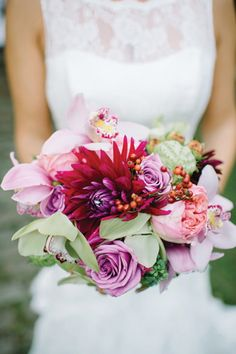 Bouquet - blue moon roses, pink peonies and cymbidium orchids, green heleborus and a dahlia
