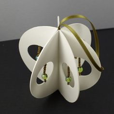handmade PAPER ORNAMENT ... luv the open circles with a strung bead each ...