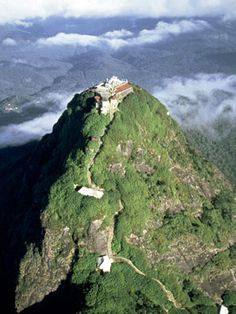 'Rising majestically above the surrounding hills, Adam's Peak – Sri Lanka's holiest mountain – attracts hundreds of thousands of pilgrims each year who, along with foreign visitors, climb to its summit.' Sri Lanka: the Bradt Guide; bradtguides.com/srilanka