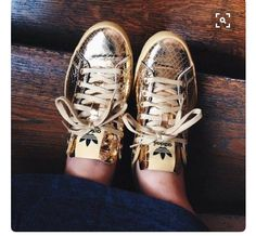 Adidas Originals Rod Laver x Jeremy Scott gold foil lace up sneakers with  trefoil branding to tongue. 1da7b3732f