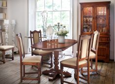 Aldeburgh Dining Table with Lancaster dining chairs from Old Charm.   Simple 3' sideboard and dresser top with internal touch lighting.  #dining #living #oak #oldcharm