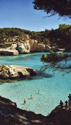 Cala Mitjana - Menorca Island, Spain I think this has to go on my bucket list. I want to stand in that water :)