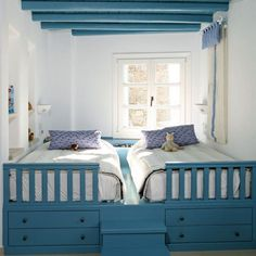 Twin mattresses on one platform with storage drawers beneath & little steps built between the drawers & mattresses - Good idea for 2 children who have to share a small room