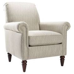 "Nailhead-trimmed arm chair with espresso-finished legs and a rolled back. Made in the USA.  Product: ChairConstruction Material: Wood and fabricColor: Espresso and linenFeatures:  Nailhead trimMade in the USADimensions: 39"" H x 37.5"" W x 21"" D"