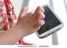 Little girl using mobile - stock photo