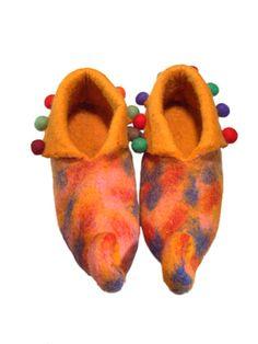 Felt shoes and slippers, felt wool crafts, handmade felt craft, felt accessories, felt rugs, felt ball wholesale http://www.nepalartshop.com/felts.php