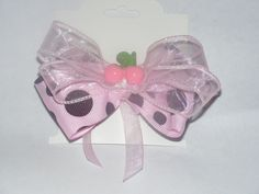 Dbl. layered bow with center embellishment.  Several toppers available. - $5