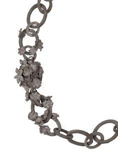 demi thomloudis, cement necklace close up