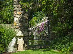 Stone wall iron moongate garden gate at Copper Beech Farm