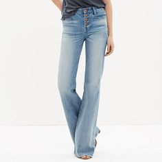 """These leg-lengthening jeans are our own icon in the making. With a high rise and a 34"""" inseam, they give you that '70s cover-girl look—not to mention an unbeatably sweet rearview. Just add heels. <ul><li>Sit slightly above hip.</li><li>Fitted through hip and thigh, with a flare leg.</li><li>Front rise: 9 3/4"""".</li><li>Inseam: 34"""".</li><li>Leg opening for size 25: 23"""".</li><li>Premium Candiani denim.</li><li>98% cotton/2% elastane.</li><li>Button fly.</li><li>Machine…"""