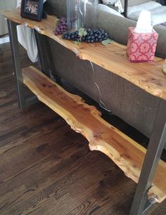 These sofa/entry tables can be made to your liking (one shelf or two shelves). The wood can be made from: walnut, rock elm, or cherry wood. We can even do aged barn wood! Pricing depends on the height and if you want one or two shelves. Each slab is 10-12 wide and 1.5-2 thick -walnut is a dark brown tone and rock elm is a danish brown tone with high grain tones (ad pic). *Under buyer notes leave the type of wood and exact height you want it to be, also request the leg color: raw steel…