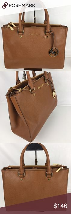 """Michael Kors Sutton Large Satchel Condition: Gently Used - a few light marks on exterior.  High-shine logo letters finish a sophisticated, lightly structured tote crafted from saffiano leather. Optional crossbody strap not included. Double top handles with 4"""" drop. Interior features 2 zip compartments, zip pocket, 4 slip pockets and key fob. 14"""" W x 10"""" H x 4"""" D. Style 30S4GTVS7L. Our bag # RB340.  Thank you for your interest!   PLEASE - NO TRADES / NO LOW BALL OFFERS / NO OFFERS IN COMMENTS…"""