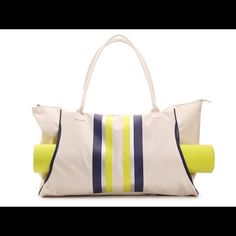 """Tote and yoga mat Yoga mat included Canvas tote Top zip closure Rolled handles with 10"""" drop Front striped details External slip pocket for yoga mat Dimensions 25"""" x 5"""" x 13½ """" Bags"""