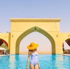 Blue swimsuit & yellow hat @chiclebelle