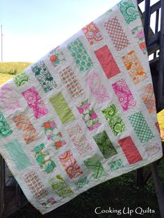"Heather Bailey ""Up Parasol"" layer cake quilt. Uses a easy brick pattern."