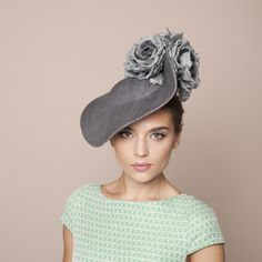 Gina Foster Millinery - Cardini - Large Hat with Roses - a grey wave coulis with grey silk rose trim. A new shape that is proving to be a popular style for all summer occasions. Secured with a hairband and worn on the right side of the head