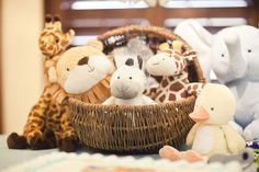 Noah's ark animal theme baby shower basket of stuffed animals