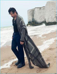 Tony Ward dons a chic long open cardigan sweater from Giorgio Armani's…