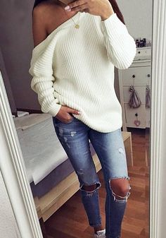 Front view of model in cream one-shoulde sweater