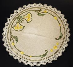 """268.Arts & Crafts round mat, unknown maker and number, ca. 1908-1913, yellow and green floss on oatmeal linen fabric with green stenciling, satin and tight herringbone stitches, conventional floral motif, 36""""dia., excellent condition 350-550"""