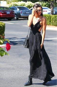 Kendall Jenner looks so pretty in this cut-out black maxi dress and black ankle boots