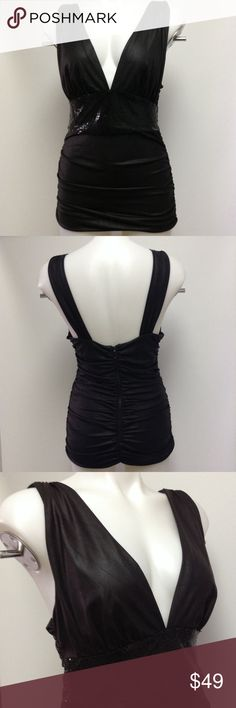 Bebe Black wet look top Size Large Bebe Black Wet look top. Great for evening or club wear.  Great pre-owned condition. bebe Tops Blouses