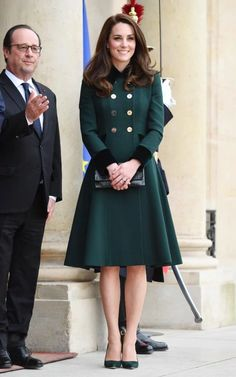 Arriving at Paris for tour, recycling Catherine Walker coat