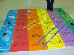 This could be done with small table version, even with different kinds of math problems, or even other subjects. Chutes and Ladders with Multiplication Division Floor Mat Family Math Night Math Multiplication, Fractions, Maths, Math Resources, Math Activities, School Resources, Family Math Night, Parent Night, Curriculum Night