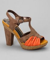 Kiss conservative goodbye and slip into something a bit more sassy. These dual-textured sandals spice up any ensemble by adding a bit of fabulous flare.3.5'' heel with 0.5'' platformMan-madeAdjustable strapImported