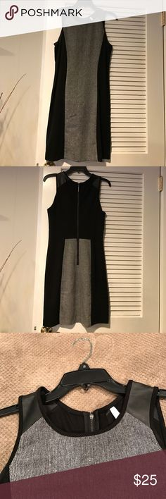 Kenzie dress Great figure flattering dress.  Faux leather at top of sleeve. Hits below knee. Worn once. Kensie Dresses