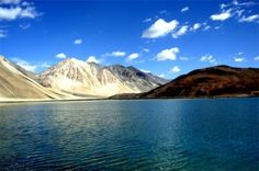 Top 10 Indian Summer Destinations you can't miss! -A trip to Ladakh – just like love – can't be expressed in words. The mighty Karakorum with its cotton-wool peaks bounds Ladakh, a terrain characterized by vast barren valleys, lofty mountain passes, beautiful lakes, and the last undisturbed home of Tantric Buddhist population.